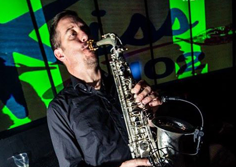 Alastair g northwest saxophonist on stage