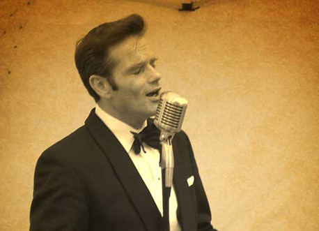 Tony Benebdict vocalist with vintage mic profile image